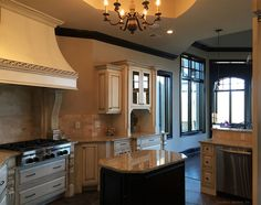 Kitchen with raised ceiling above the island. The Jasper Hill - Plan 5020. http://www.dongardner.com/plan_details.aspx?pid=4229. #Kitchen #CeilingTreatment #FloorPlan