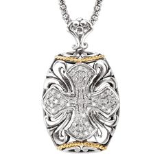 A beautiful diamond accented cross pendant in sterling silver with 18k gold accents-$599.98- Arwood's Custom Jewelry