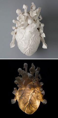 """Venus"" - Kate McDowell, 2006 {anatomical heart sculpture 9""x14""x9"", hand built porcelain, 6-glaze cone, acrylic gel, halogen light}"