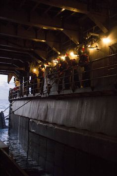 U.S. Sailors from the USS Carter Hall (LSD 50) cast off a Navy landing craft, utility carrying Marines from Combat Logistics Battalion (CLB) 26, 26th Marine Expeditionary Unit (MEU), to a beach in the 5th Fleet area of responsibility April 20, 2013.