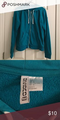 Women's H&M Zip-up Sweatshirt Women's H&M Zipped Hoodie. About: Teal hoodie with white strings. Condition: Great, there are no signs of fading. Comes from a smoke-free home. If interested and would like more pictures do not hesitate to ask. Open to offers and bundles. No trades. H&M Tops Sweatshirts & Hoodies
