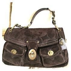 Coach Limited Edition Sue Lee Suede purse. Authentic COACH Purse LIMITED EDITION in brown suede with brass hardware and an adorable lining in excellent condition .Firm Offer (not included in bundle discount) authenticity guaranteed. Used once , no stains and lining is in perfect condition.  With tag but tag is not attached. Like NEW! Coach Bags Satchels