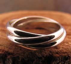 silver rolling ring by DogsKinJewelry on Etsy https://www.etsy.com/listing/97170255/silver-rolling-ring