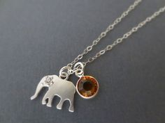 I love this too! https://www.etsy.com/listing/153246034/personalized-birthstone-necklace