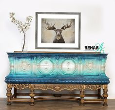 """This hand-carved beauty dates back to the 1600's and is a rare find for a Jacobean sideboard. Painted using a variety of blues some metallic and some not including navy, teal, aqua , sky blue layered with some cream and silver. This massive piece has plenty of storage with 2 drawers and 2 cabinet doors in front and 2 more cabinet doors on the sides. (Another rare feature)   This""""Modern Marries Rustic"""" design would look great in any entryway, dining area, living room, kitchen cafe, bedroom… Rustic Feel, Rustic Style, Rustic Design, South Carolina Homes, Painted Cupboards, Blue Color Schemes, Jacobean, Metallic Blue, Old Antiques"""