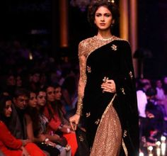 In the year, 2015, #golden and the #shimmer is one among the most demanded color #combinations. The famous #designer, #Sabyasachi Mukherji's sarees have a sparkly gold finish which is carefully chosen to go with a dull black, thereby giving it a #nouvelle look altogether. It is usually paired with a golden worked full sleeves blouse which gives it a royal look.