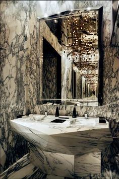 Geometrical designed marble powder room at the Ozone bar located on the 118th floor of the new Ritz-Carlton in Hong Kong #powderroom #interiordesign - More wonders at www.francescocatalano.it