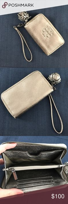 Tory Burch Pewter Thea Wallet 3 credit card slots, coin purse and pocket to hold cash, a checkbook or a smaller iPhone (iPhone SE!) cute pom pom zipper and wristlet. Tory Burch Bags Clutches & Wristlets