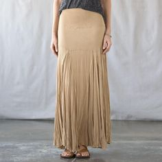 """JERSEY SWIRL SKIRT�--�On the Playa or your own patio, you won't find an easier, more sensuous skirt than this maxi in silky jersey, patched and pieced for maximum flattery. Elasticized waist. Rayon/spandex. Dry clean. USA. Sizes XS (2), S (4 to 6), M (8 to 10), L (12 to 14). 40""""L."""