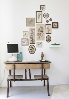 vintage school desk & collection of embroidered birds on the wall