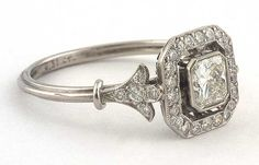 Doyle & Doyle: Princess cut vintage diamond ring