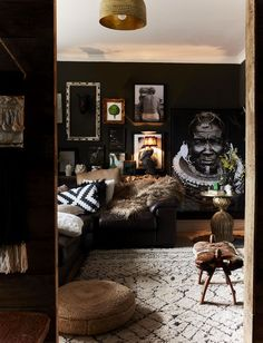 Tons of pillows and textures on the couch metaled it less formal. The extraordinary home of Shelley Carline as featured in the Rockett St George book: Extraordinary Interiors. African Bedroom, African Living Rooms, African Interior Design, Living Room Decor, Bedroom Decor, Star Bedroom, Muebles Living, African Home Decor, Dark Interiors