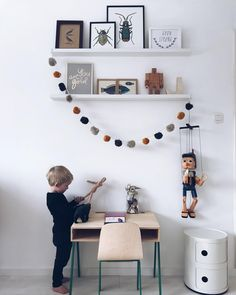 A beautiful kids room by Instagram @HAAIKIE with a fun mix of toys, decor, quotes and nature.