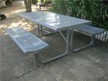 Outdoor picnic table with benches. ADA accessiable.