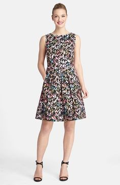 Here's the Dillard's Dress also available at Nordstrom. A bit of contrast trim traces the neck and armholes of a sleeveless party dress sprinkled with pretty watercolor petals.