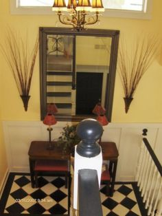 Mirror with vases on either side...  google search (stairwell landing decorating)