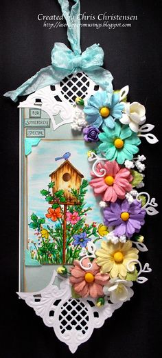 I wanted to get more use out of the very sweet Wildrose Studio Birdhouse stamp. A little change here and there and I've turned it from a Winter stamp into a Spring/Summer stamp! For more info, please visit my blog:  http://ascrappersmusings.blogspot.com/2014/04/my-wild-rose-birdhouse-stamp-transition.html