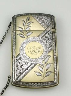 """N4169 Wood and Hughes sterling card case.  A pristine sterling silver card case with original chain. The surface is engraved with a Japanese style of engraved decoration with flowers and insects. The top hinges to open the case and there is an embossed band of ornate decoration on the edge on both sides. 4"""" by 2 1/4"""". Weight: 2.2 troy oz.    Price: $650.00"""