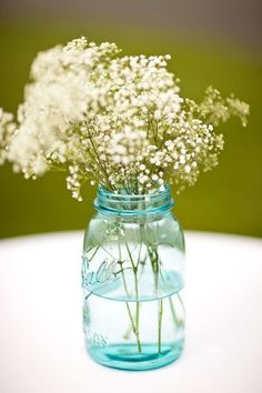 Another mason jar- again, not blue. Baby's breath is beautiful massed out this way, and could be used with another arrangement on either the dining tables, or on your ceremony shelf