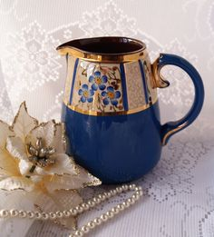 A most unusual and sumptuous vintage jug/ pitcher. Decorated in cream, lapiz blue and gold. A superb gift. by Alexsprettyvintage on Etsy