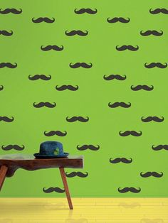 peel and stick wallpaper. not so bad an idea for trendy patterns like these moustaches, expensive though for someting temporary