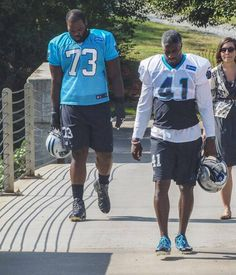 Carolina Panthers Michael Oher (73) and Roman Harper (41) head to practice. The Carolina Panthers held practice 09.10.15 midday at their practice field near Bank of America Stadium.