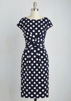 Spotted from a Distance Dress  Walking to meet an old colleague for drinks in this navy sheath dress, you wonder if shell recognize you after all this time. Clad in the classic white dots and wrap-inspired waistline of this silky knit midi, you see her smiling and waving - turns out refined styling is still your signature! The post  Spotted from a Distance Dress  appeared first on  Vintage & Curvy .  http://www.vintageandcurvy.com/product/spotted-from-a-distance-dress