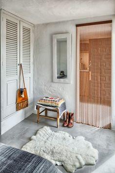sheepskin rug, bench, cushion, beaded doorway