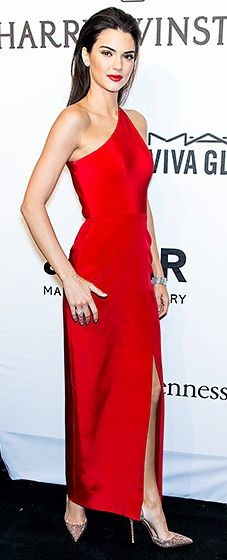 Stunner! Jenner looked regal in a red Romona Keveza gown paired with Christian Louboutin pumps and Harry Winston jewels.