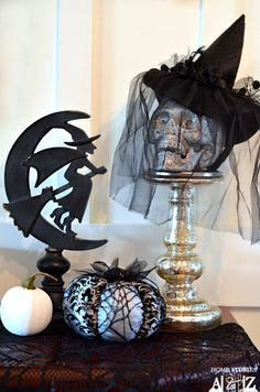 Easy and so cute! Dollar store skull and witches hat, some black netting or mesh... Stocking pulled over a decorative white pumpkin.. Love it.