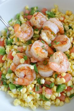 This is the perfect summer salad that is sure to impress at any BBQ - grilled shrimp and corn salad petitfoodie.com