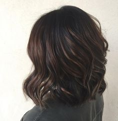 Any brunette knows that features seem weighed down if they don't have some sort of hair-incorporated pick-me-up. Go for a highlight shade that's only a few shades lighter than the bulk of your hair.