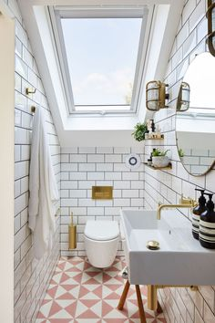 Short on space? Pink geometric tiles perfectly pair with our MPRO Brushed Brass brassware in this cloakroom photographed. Small Attic Bathroom, Loft Bathroom, Bathroom Plumbing, Upstairs Bathrooms, Bathroom Interior, Loft Ensuite, Small Bathrooms, Bathroom Beach, Family Bathroom