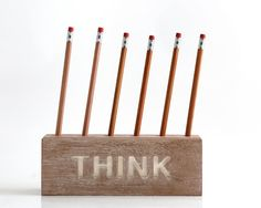THINK desk organizer for pencils, brushes and pens on Etsy. Really like this.