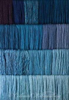 Studio photography of various colors of yarn dyed at the Weaver's shop in Colonial Williamsburg. Shot for book by Max Hamerick on dyeing textiles; Blue dyed with Indigo Photo by Barbara Temple Lombardi Z