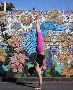 Debi Hendra doing Adho Mukha Vrksasana- Handstand
