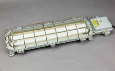 Alligator | Explosion proof industrial tube fixture with cage