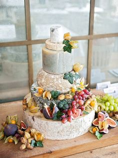 Skip the sweet: wheels of cheese topped with fresh grapes and figs!