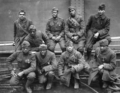 "Members of the all-black 369th Infantry Regiment, nicknamed the ""Harlem Hellfighters."" Photo was probably taken after the end of World War I on the boat back home."