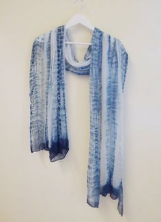Beautifully airy and light weight natural cotton muslin, hand-dyed with indigo.  Perfect as a summer shawl or scarf. Could also be used as a baby