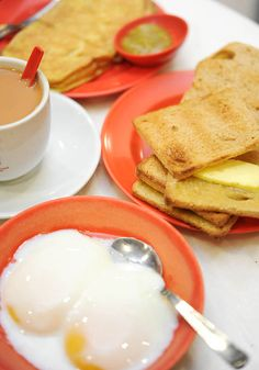 "The ""Singapore Breakfast"" of the older generation: half boiled eggs, coffee, and toast with butter and kaya"
