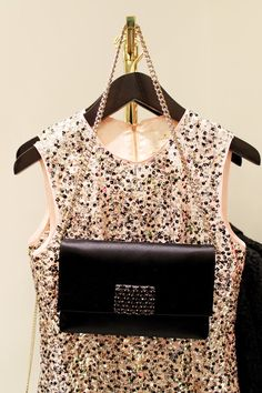 A pale pink sequinned dress and a classic black bag with a gold chain. I'm in Kate Spade heaven.