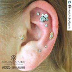 #Repost @vaughnbodyarts - ・・・ We've had the pleasure of doing all of Deni's cartilage piercings. They have all healed up great, so it was time for a new addition. Deni saw our post with the new Sabrina ends from @anatometalinc and picked out this lovely piece for her new cartilage piercing. We love how this piece ties everything together aesthetically. Gold, diamonds, and CZ's. Classic! Thank you as always, Deni! #app #appmember #safepiercing #anatometal #jewelry #bodyjewelry #hel...