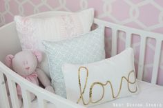 Love this 'Love' pillow - a perfect fit in this glam girl's nursery! #projectnursery