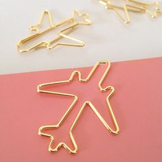 New planner clip shapes have just arrived in our shop, hashtags, flowers, bows and these super cute planes.