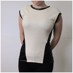 Halogen faux leather panel top sz XS -WELCOME to my addiction :-)-  I always have NEW items posted frequently so please keep checking back :-)!  BUNDLES are more than welcome and encouraged to save you shipping!  Please refer to description and photos to see fit.   BRAND: halogen SIZE: XS COLOR: black beige  CONDITION: preowned   BUST: 14in WAIST: 13.5in SLEEVE LENGTH: none LENGTH: 22.5in   Other details: looks like faux leather. Zipper in back. Stretchy. Made in Canada.   NO SWAPS/TRADES…