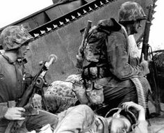 Tarawa 20th November 43 Landing on the beach under heavy machine gun fire with a dead marine beside them.one can only imagine the hell that was thier that day many marines died for this spec in the ocean