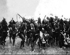 Lakota Sioux men and boys perform a war dance on the Pine Ridge Agency, South Dakota. Date 1890? December 25th.