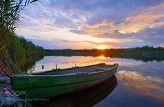 Fisherman boat on Danube Delta by jordachelr. @go4fotos