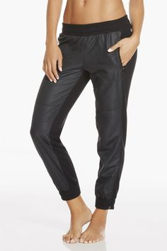 Put this black jogger into your street wear rotation. Its mixed media ripstop fabric keeps the aesthetic sporty and its terry base keeps you cozy at the same time. | Anguilla Jogger - Fabletics